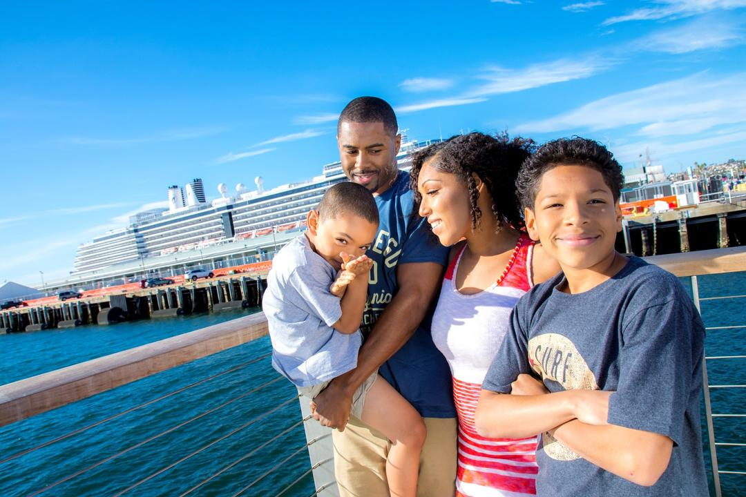 a family of four enjoys a sunny day at the Embarcadero at the Port of San Diego