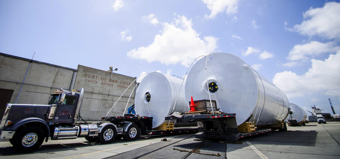 two huge beer fermenting tanks await transport at the Tenth Avenue Marine Terminal Port of San Diego