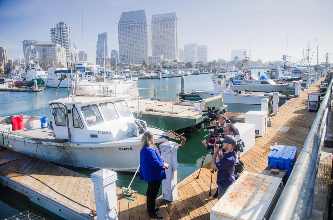 Port of San Diego press conference at Tuna Harbor - boats in the water, people on the docks