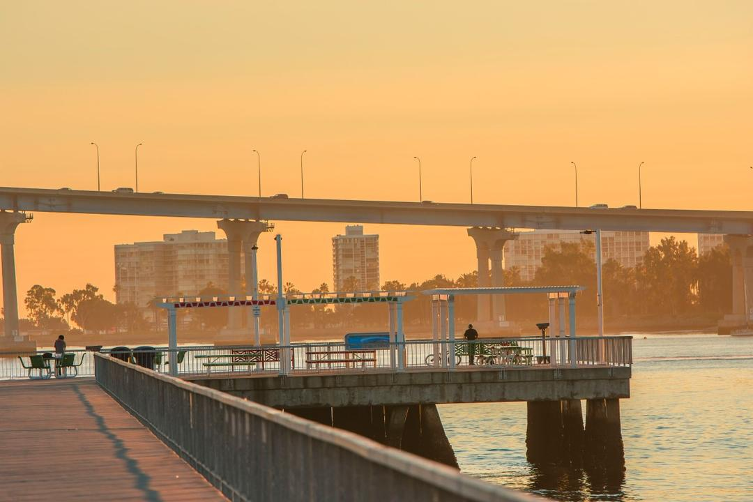 Beautiful view of the Coronado Bridge and waterfront from the recreational pier at Cesar Chavez Park at the Port of San Diego