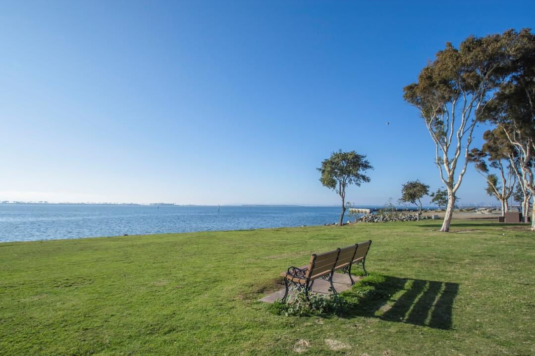Bench on grass overlooking water at Chula Vista Bayside Park at the Port of San Diego