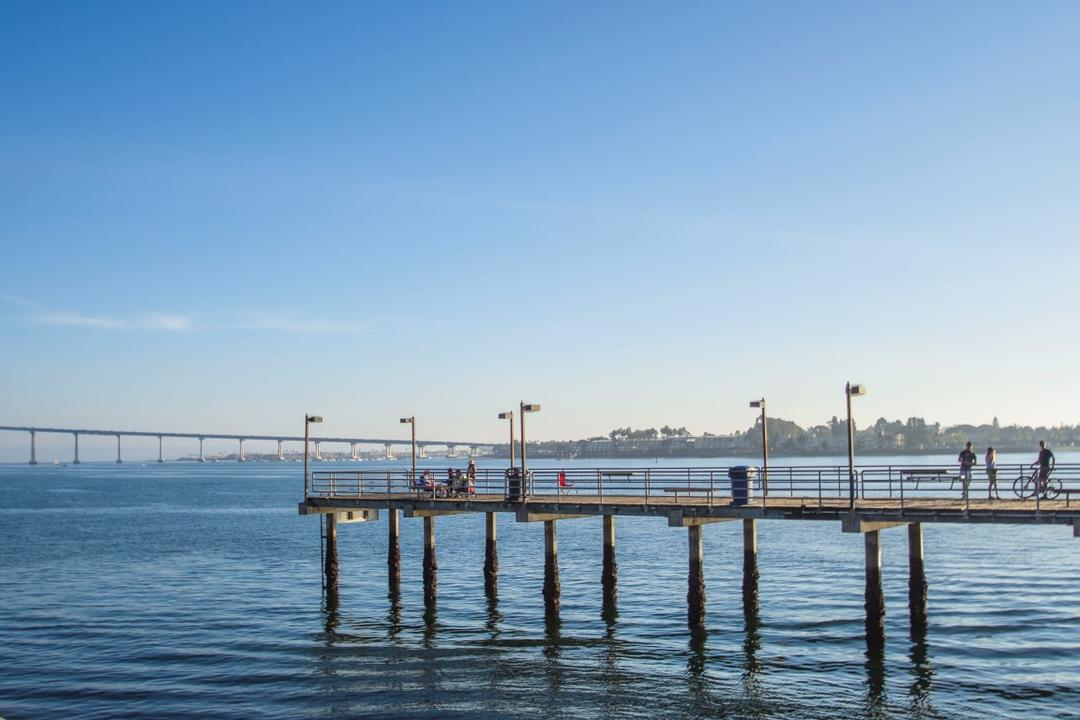 Fishing pier and view of the San Diego-Coronado Bay Bridge at Embarcadero Marina Park South at the Port of San Diego