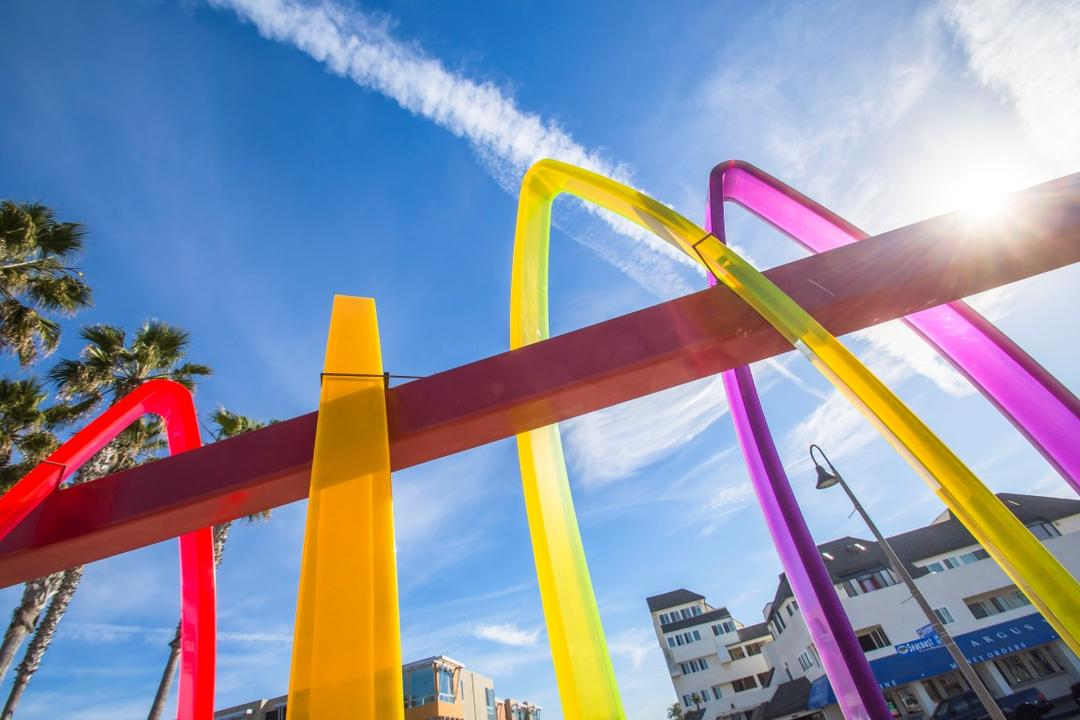 Worm's-eye-view of Surfhenge acrylic sculpture by Malcolm Jones at Portwood Pier Plaza at the Port of San Diego