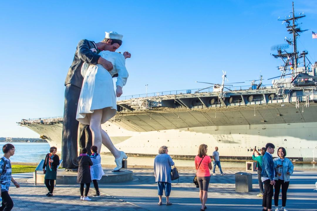 Embracing Peace painted sculpture by Seward Johnson in front of USS Midway at Tuna Harbor Park at the Port of San Diego