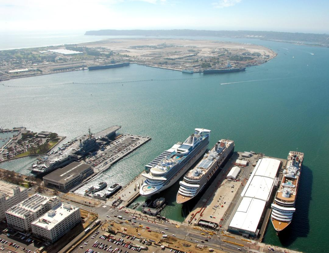 an aerial view of the San Diego Bay from above downtown San Diego looking at the cruise ship terminals over the water and towards Point Loma