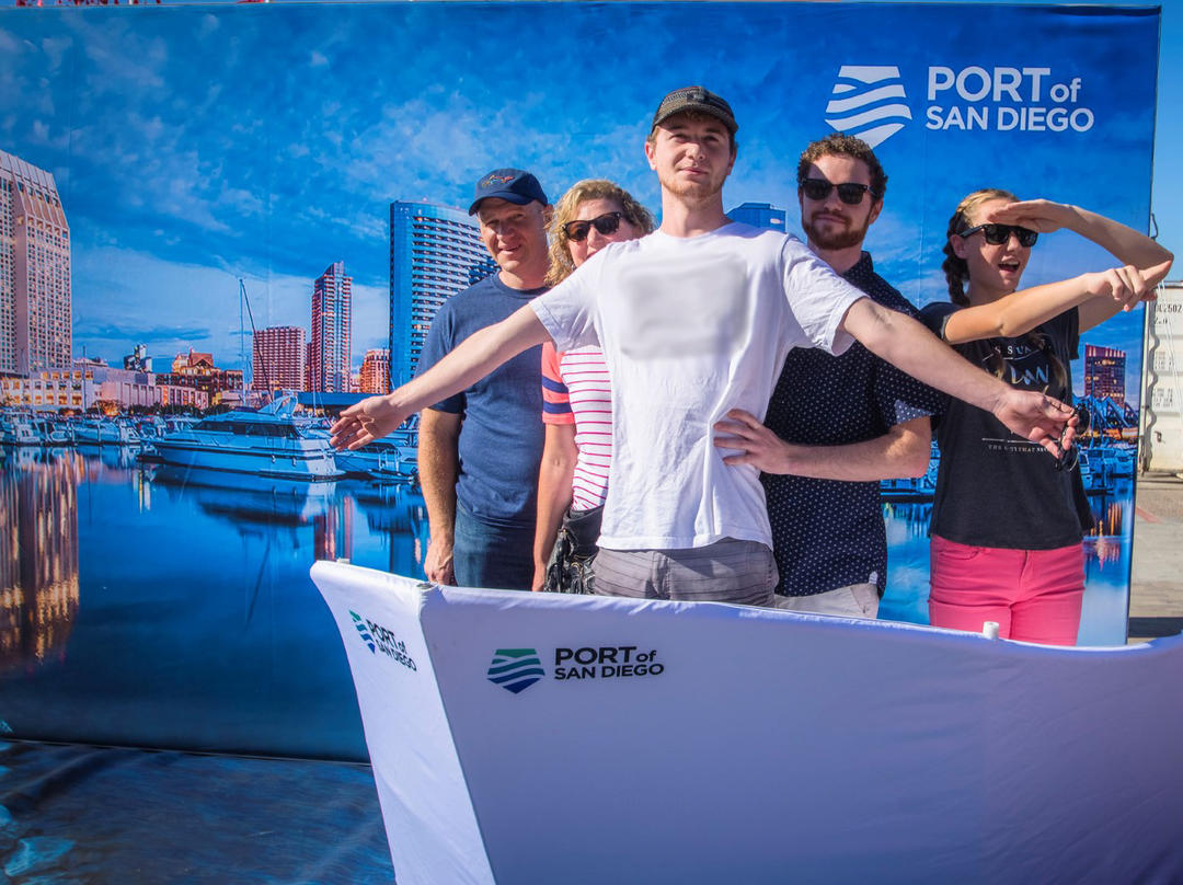 a group of people take a fun photo in the Port of San Diego Dream Booth