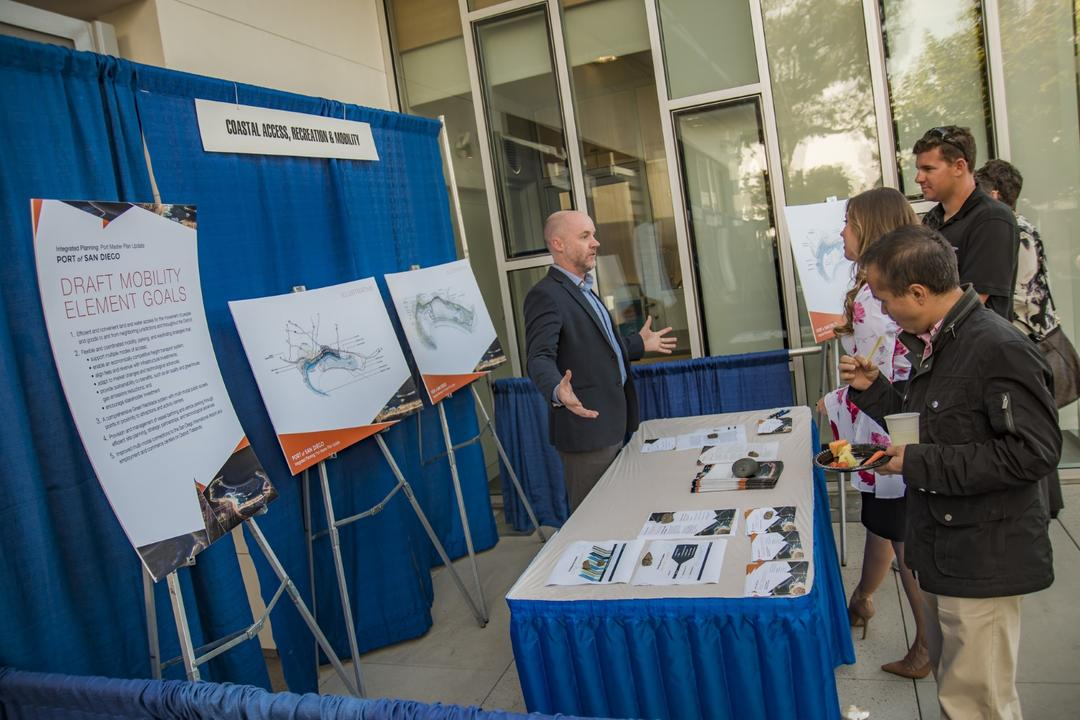 a booth display with people talking to the subject matter expert at a Port of San Diego meeting