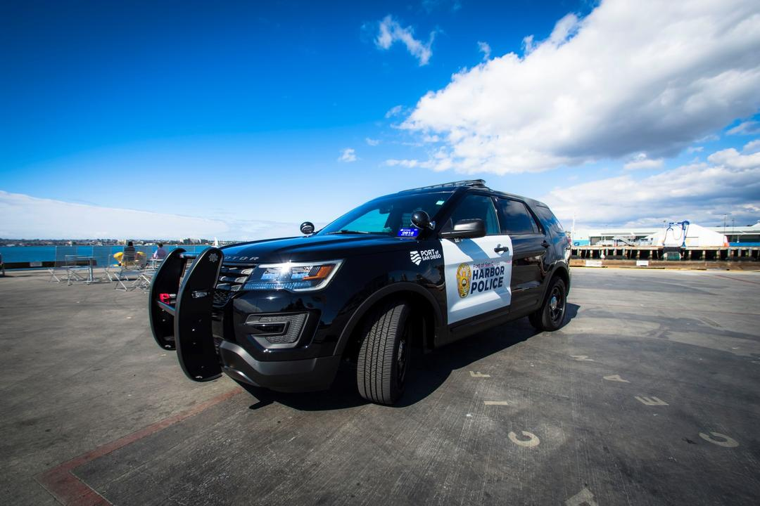 a Harbor Police SUV sits in a parking lot.