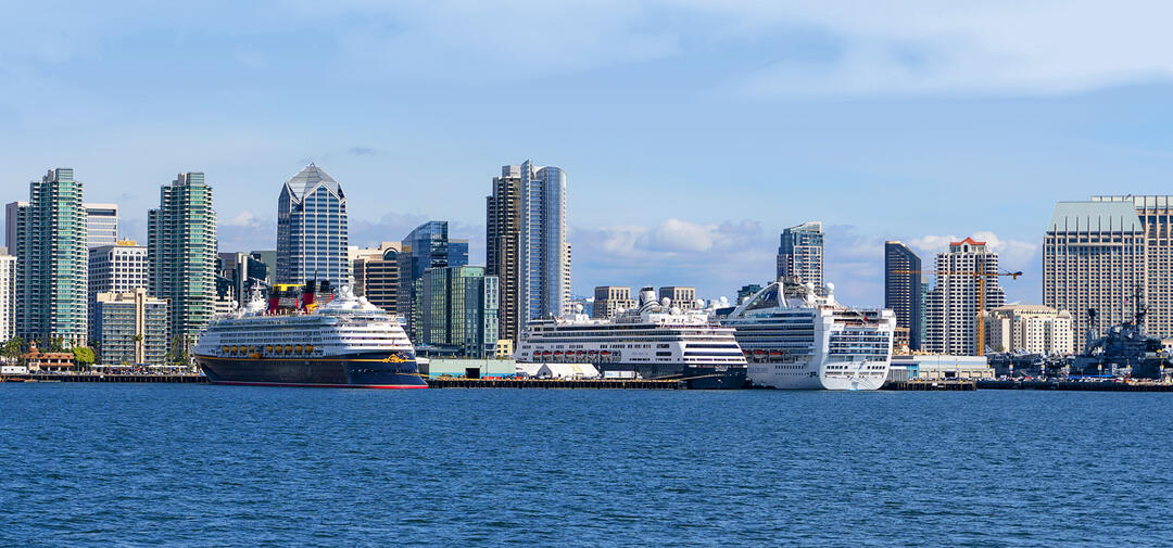 A view from the San Diego Bay towards downtown San Diego with a cruise ship in port
