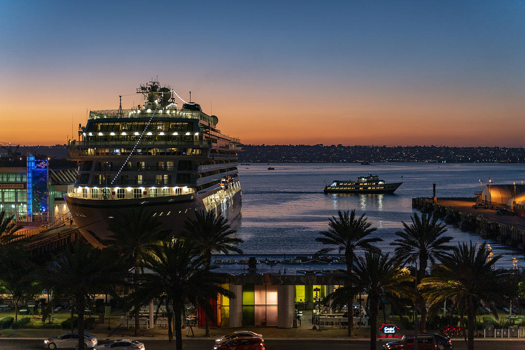 A cruise ship docked at the Port of San Diego at sunset.
