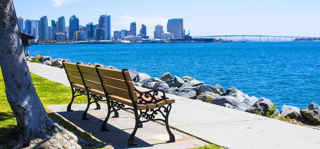 benches on Harbor Island with the city of San Diego in the background