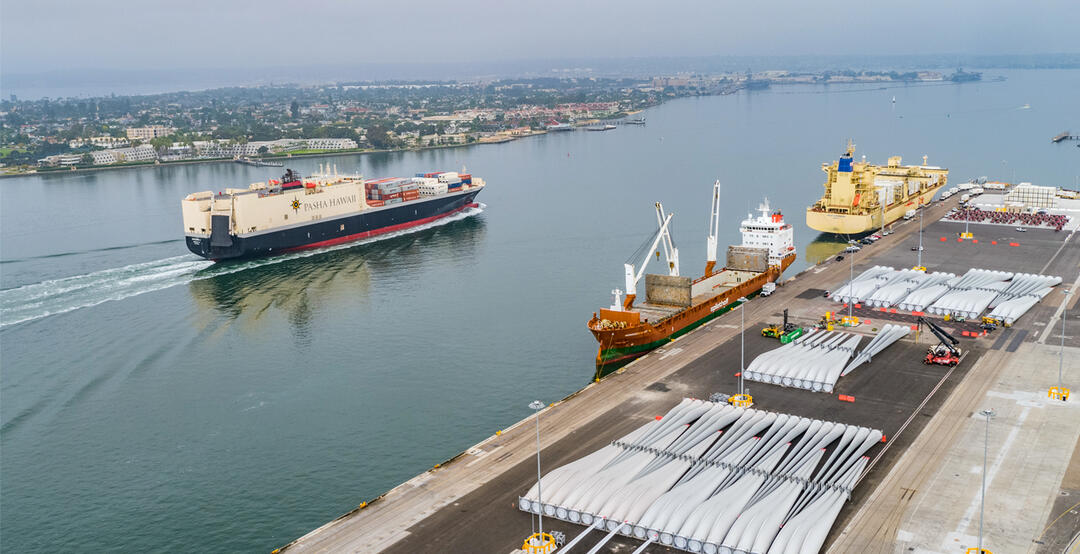 Aerial view of San Diego Bay with a ship sailing by the Tenth Avenue Marine Terminal.