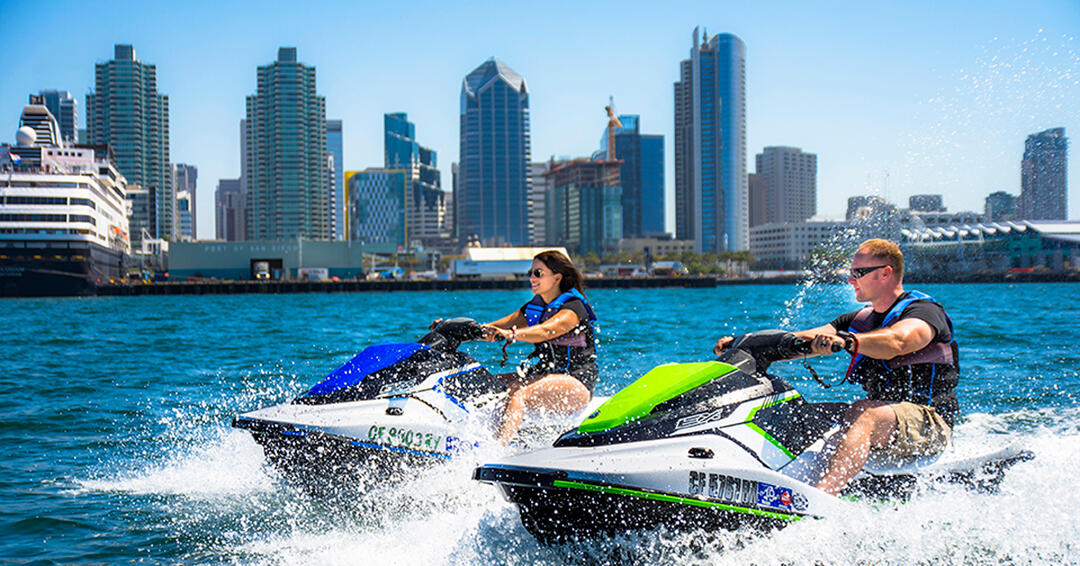 Embarcadero Experience Jetskis - a couple dart about the San Diego Bay on rented jetskis
