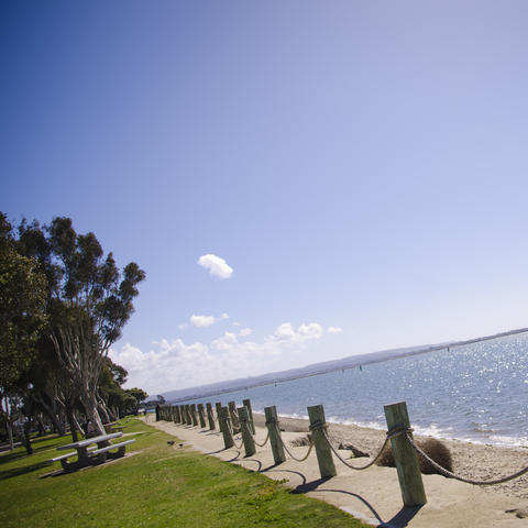 View of the blue sky and the blue water of San Diego Bay from Chula Vista Bayfront Park.