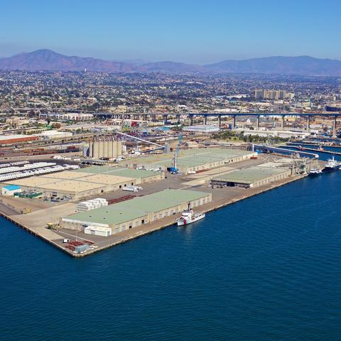 Aerial view of the Port of San Diego's Tenth Avenue Marine Terminal with mountains in the background.