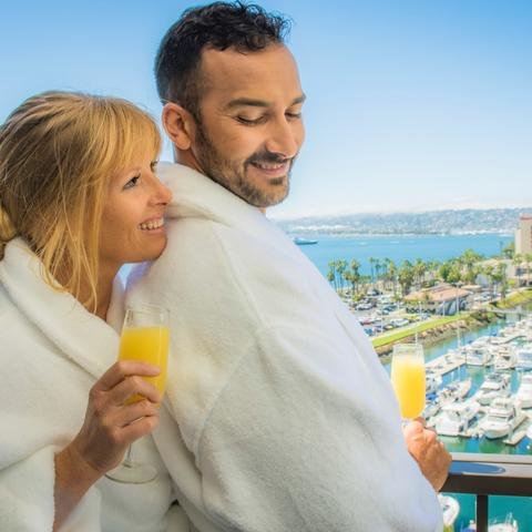 Harbor Island -a couple has breakfast on the balcony Port of San Diego