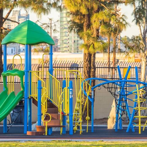 Playground with slides, steps, ladders, nets, and mini rock climbing walls at Cesar Chavez Park at the Port of San Diego