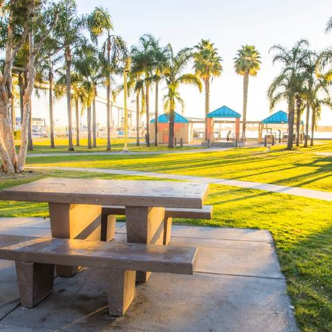 Table, grass, and trees at Cesar Chavez Park at the Port of San Diego