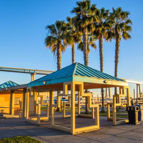 Gazebo, trees, and view of Coronado Bridge at Cesar Chavez Part at the Port of San Diego