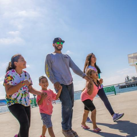 Family enjoying the recreational pier at Cesar Chavez Park at the Port of San Diego