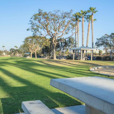 Picnic tables and grass at Chula Vista Marina View Park at the Port of San Diego