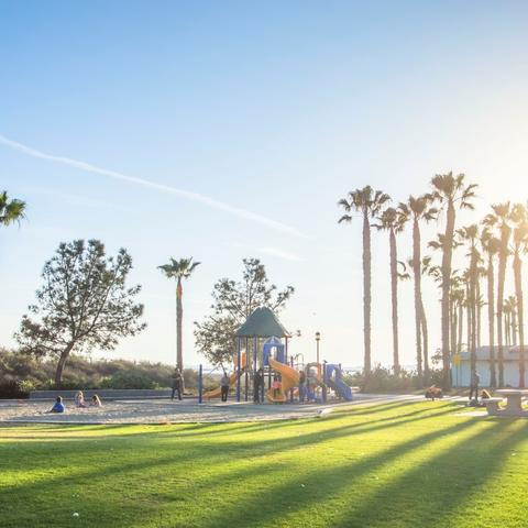 Playground, trees, sand, and grass at Chula Vista Marina View Park at the Port of San Diego