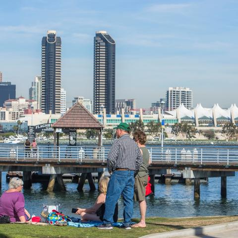 Family on grass at Coronado Landing Park at the Port of San Diego