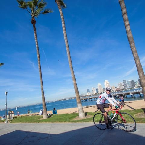 Cyclist riding along Coronado Landing Park at the Port of San Diego