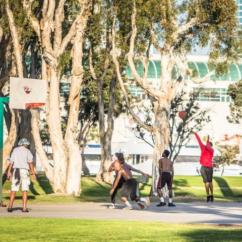 People playing at the basketball court at Embarcadero Marina Park South at the Port of San Diego