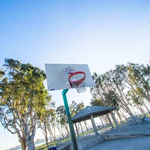 Basketball court surrounded by trees at Embarcadero Marina Park South at the Port of San Diego