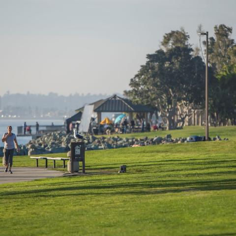 People jogging at Embarcadero Marina Park South at the Port of San Diego