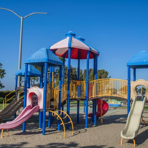 Playground over sand with slides and ladders at Pepper Park at the Port of San Diego