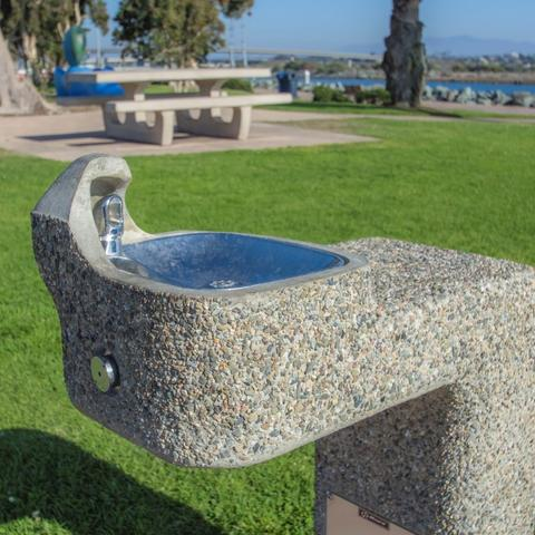 Drinking water fountain surrounded by luscious, green grass at Pepper Park at the Port of San Diego
