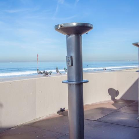 Public beach outdoor showers at Portwood Pier Plaza at the Port of San Diego