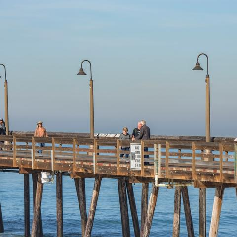 People walking over the pier at Portwood Pier Plaza at the Port of San Diego