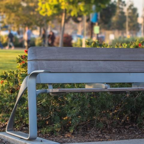 Bench in front of flower bush at Ruocco Park at the Port of San Diego