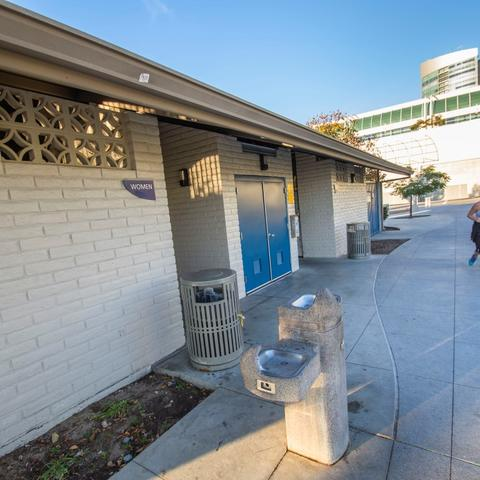 Restroom with white brick exterior and drinking water fountains at San Diego Bayfront Park at the Port of San Diego
