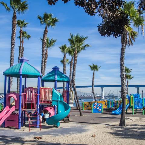 Playground, trees, and sand at Coronado Tidelands Park at the Port of San Diego