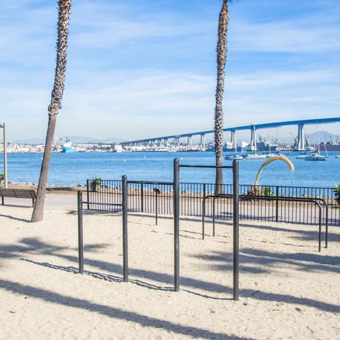 Exercise station on sand with view of San Diego-Coronado Bay Bridge in the background at Coronado Tidelands Park at the Port of San Diego